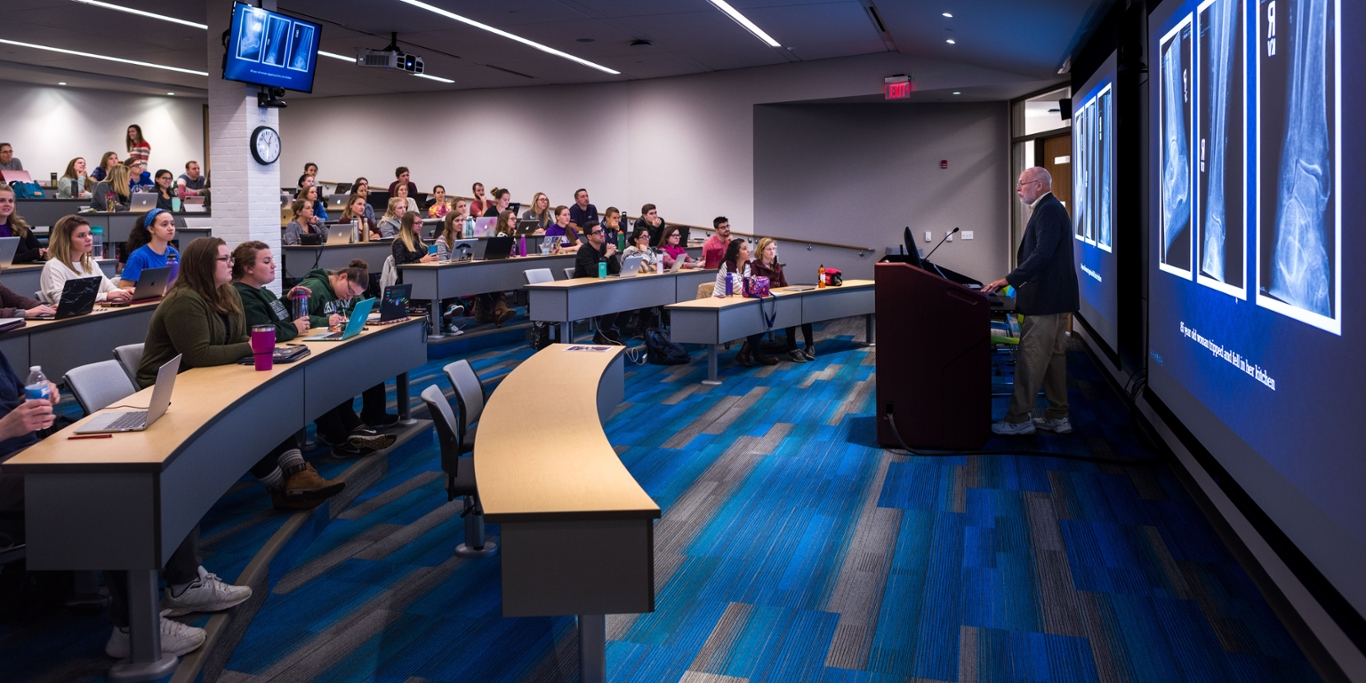 Photo of a professor teaching a classroom of Chatham University students in an auditorium at the Eastside campus.