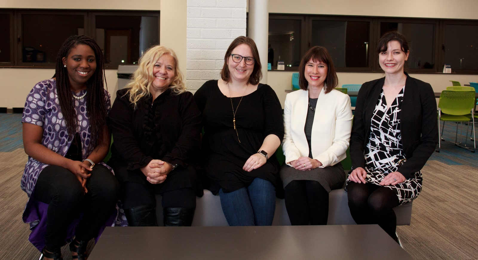 Photo of five smiling women seated in Chatham's Center for Women's Entrepreneurship