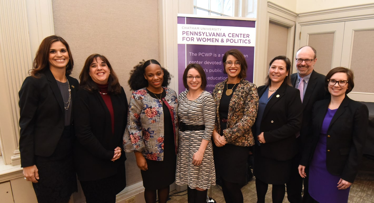 Photo of Chatham's president with seven women, smiling at the camera.
